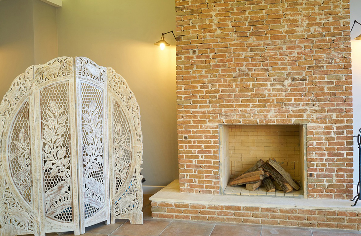 Exposed wood fireplace