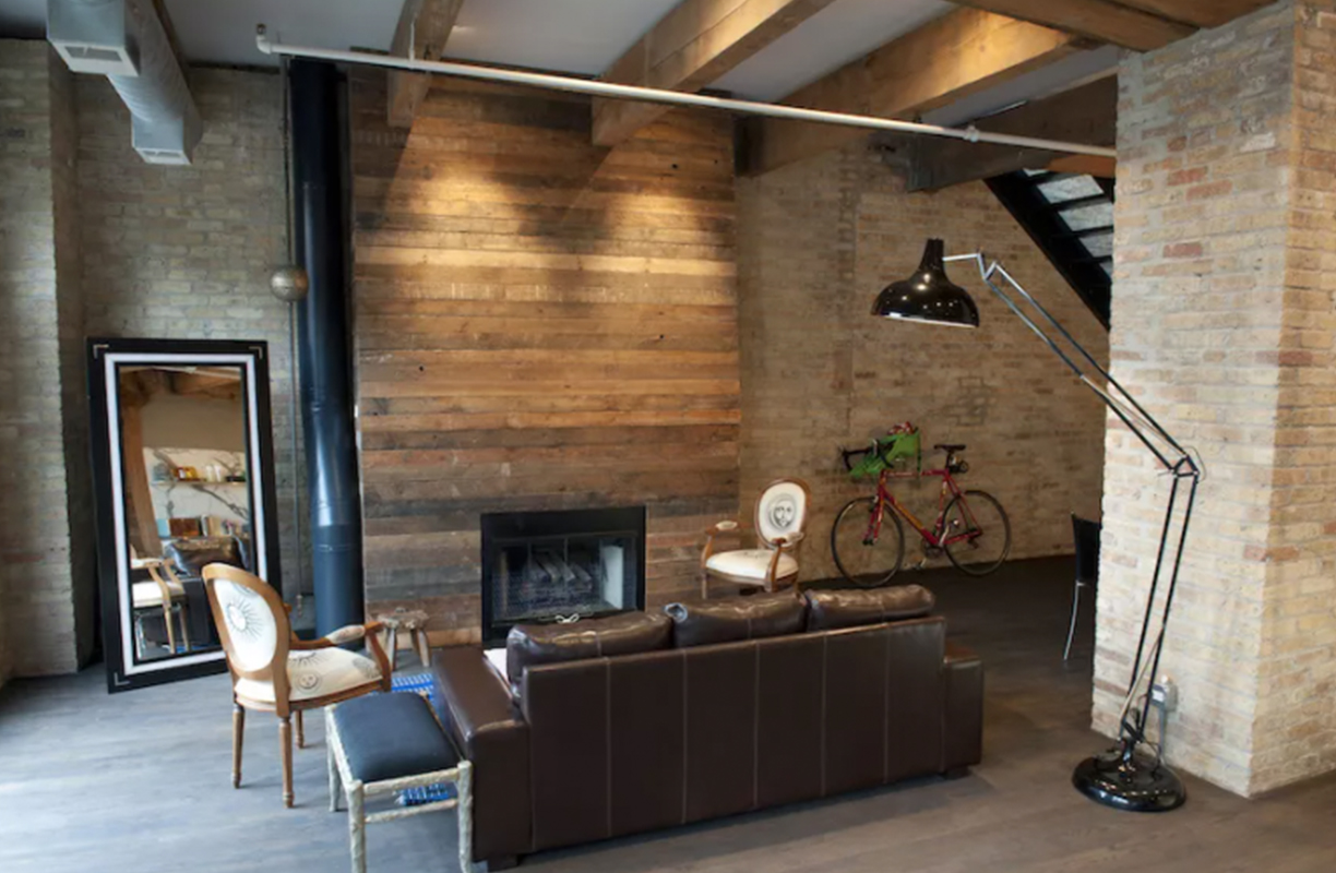 Reclaimed wood fireplace in loft apartment