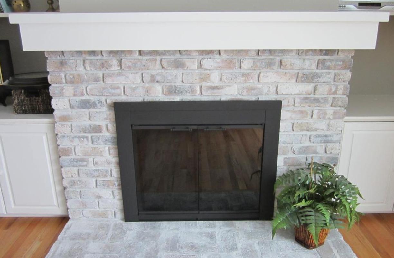 exposed whitewashed brick fireplace
